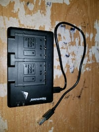 Battery charger for camera battery
