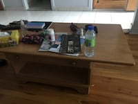 A beige wooden tv stand and coffee table $100
