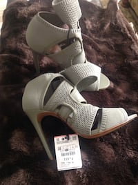 Brand new pair of grey fabric open-toe  high heeled sandals in size 38. Toronto, M1R 2G8
