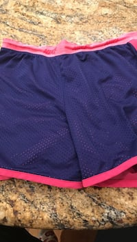 Black and pink Nike short shorts