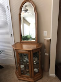 Oak curio cabinet with matching mirror . Elkridge, 21075