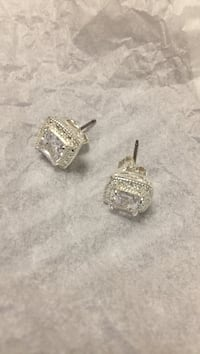 Pair of square silver-colored stud earrings