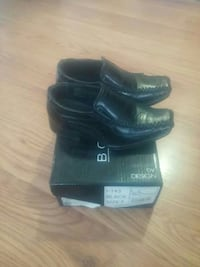pair of size 5 black leather square-toe loafers wi