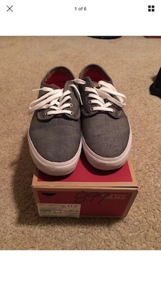pair of gray Van's shoes with box