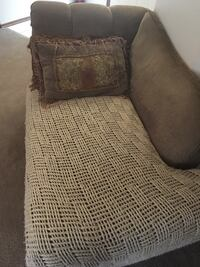 beige chaise lounge with throw pillow