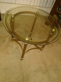 round glass top table with brown wooden base Brea, 92821