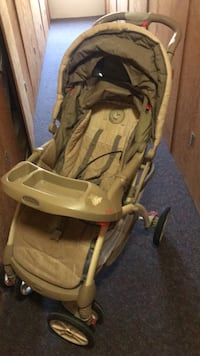 baby's brown and gray stroller