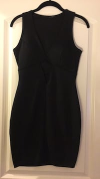 Medium  Black Bodycon dress with triangle cut out under bust 55 km