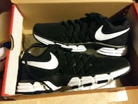 black-and-white Nike running shoes