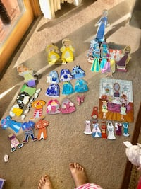Melissa & Doug wooden magnetic dolls with clothes. Fun to dress up!