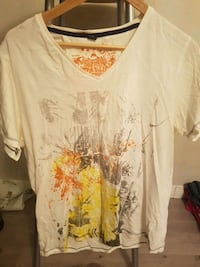 white and yellow printed v-neck t-shirt