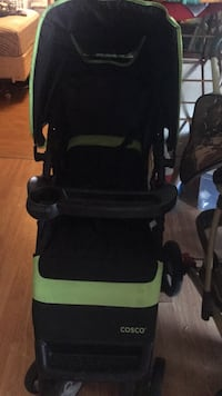 baby's black and green Cosco stroller