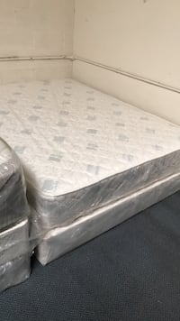 white and grey bed mattress