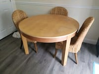 "48""round kitchen table with 4 chairs. Includes 1 leaf  North Potomac, 20878"