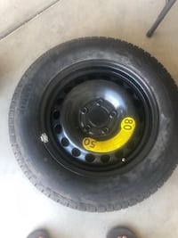 black bullet hole car wheel with tire Lake Elsinore, 92595