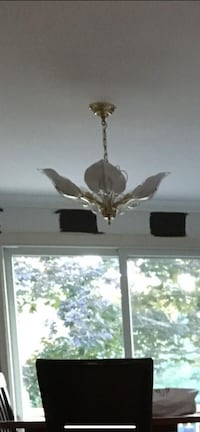 Matching chandeliers entryway/dining room set.
