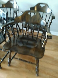 two brown wooden windsor chairs 585 mi