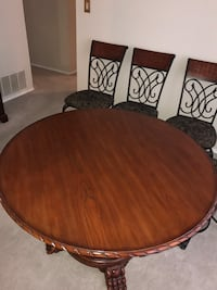 round brown wooden table with four chairs dining set San Antonio, 78231