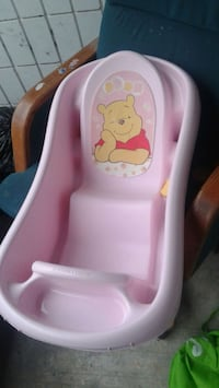 baby's pink plastic bather 1960 km