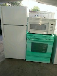 Nice and clean kitchen set of fridge(new) stove , microwave