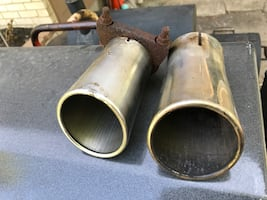 Two stainless steel mufflers tips
