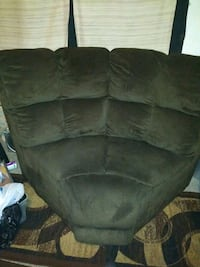 Power reclining sofa with wedge