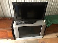 Save on this Nice tv and stand with remote all good Lincoln, 68528