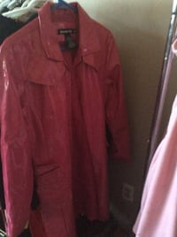 Pink button-up long sleeve rain coat.  Memories Calgary, T2A 3V6