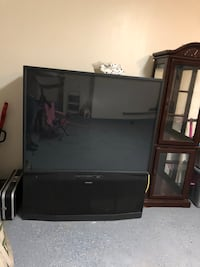 black wooden TV stand with flat screen TV 1188 mi