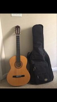 brown and black classic guitar and black gig bag Fresno, 93720
