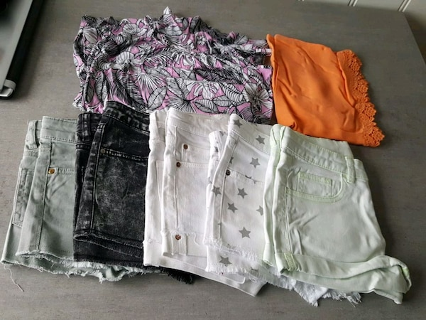 5 shorts and 2 tops very good condition Hbo 250