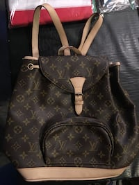 Monogrammed black and brown louis vuitton leather backpack