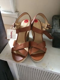 Pair of brown leather open toe ankle strap wedges Michael kors  West Hempstead, 11552
