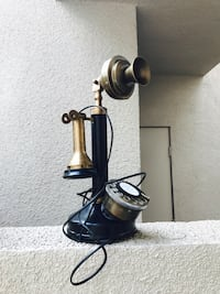 black and gray candlestick telephone