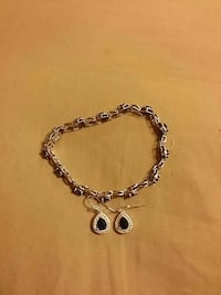 silver-colored box chain bracelet with pair of onyx hook earrings