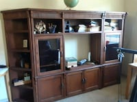 brown wooden TV hutch with flat screen television Flower Mound, 75022