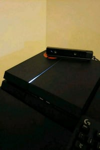 black Sony ps4 with games headset and controller Kelowna, V1W