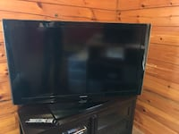 black flat screen TV with remote Myersville, 21773