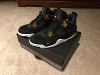 pair of black Air Jordan 4's on box Port Coquitlam, V3C 1V9
