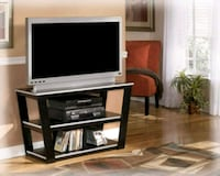 white wooden TV stand with flat screen television McAllen, 78503