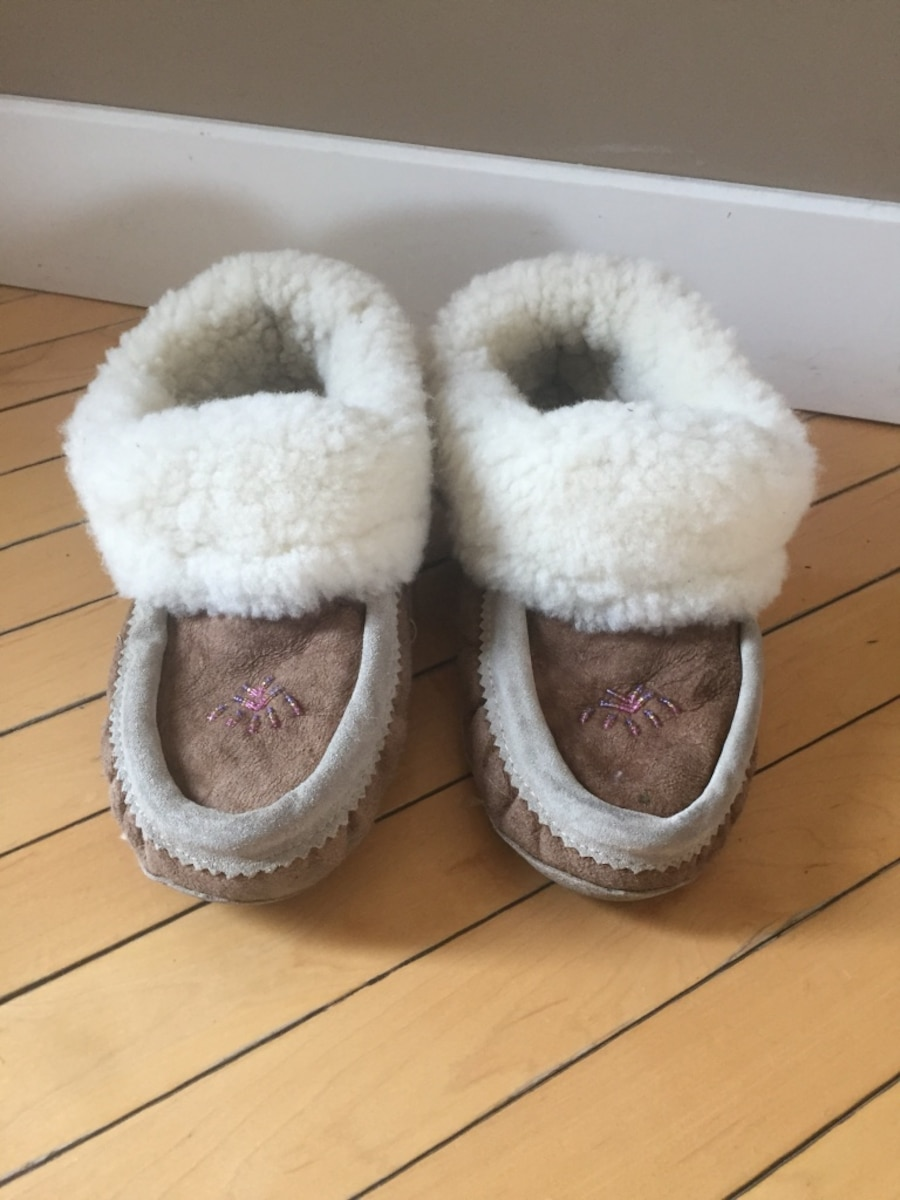 Pair of brown and white fur moccasins