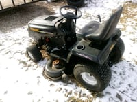 black and gray ride-on mower 810 mi