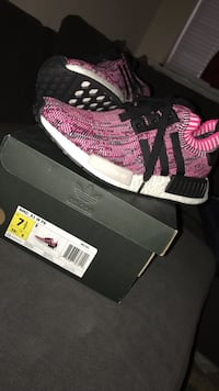 Pair of pink-and-black adidas nmd r1 shoes with box Pflugerville, 78660