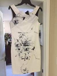 Special occasion dress hem line above knee never worn size 4 Los Angeles, 91602