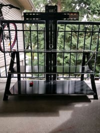 Glass tv stand good condition Vancouver, V5L 1W5