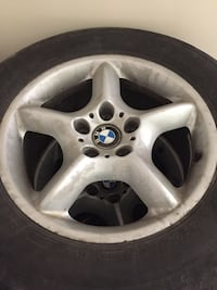 Gray 5-spoke car wheel with tire Toronto