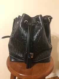 Dooney and Bourke Embossed Large Black Bucket Bag