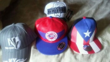 two red and blue fitted caps