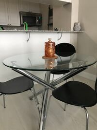Glass pedestal Dining Table