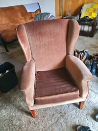 brown wooden framed gray padded armchair North Vancouver, V7N 2G3